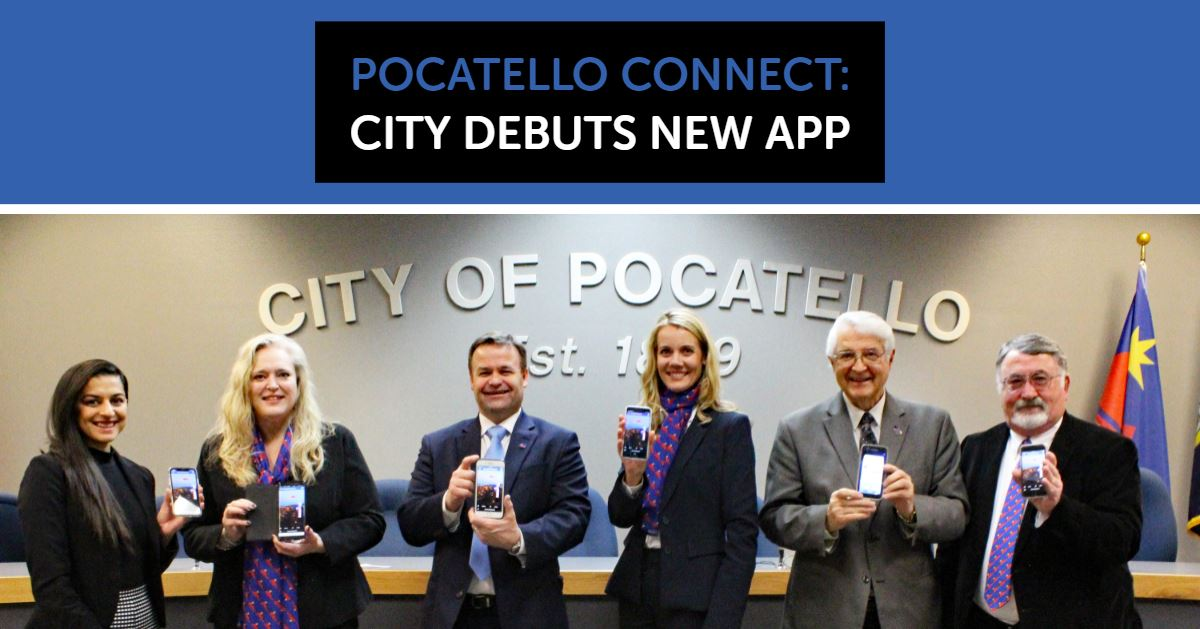 Mayor Brian Blad and members of the Pocatello City Council hold up their phones after installing the