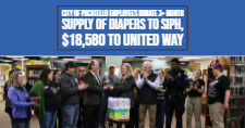 Cutline Info: Pocatello City Councilwoman Linda Leeuwrik presents the City of Pocatello diaper drive